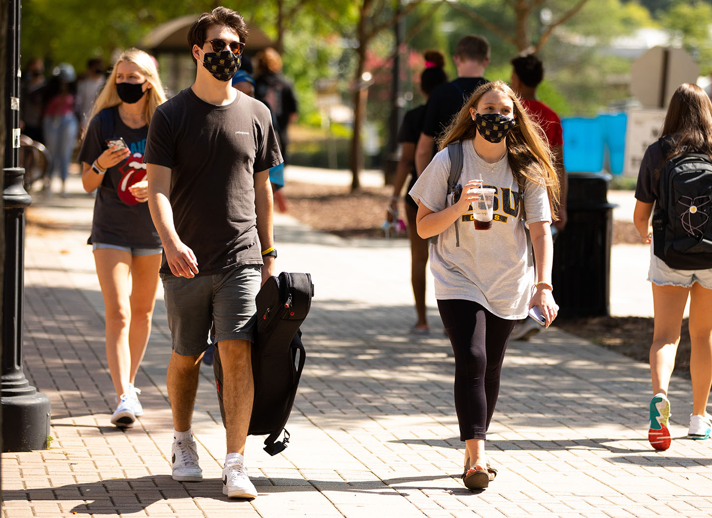 students walking with masks